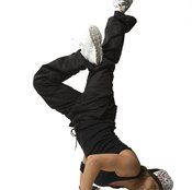 Upper body strength is important when performing break dancing moves.