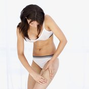 The leg extension targets the quadriceps muscles on the thigh.