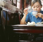You'd have to drink a great deal of tea to affect your athletic performance.
