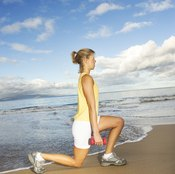 To make lunges more challenging, hold a pair of dumbbells.