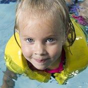 Teaching a toddler to swim takes patience and time.