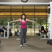 Use two cables to exercise your pectoral muscles.