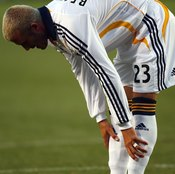 David Beckham of the L.A. Galaxy checks his shin guards.