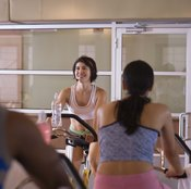 An exercise bike works various muscles in the body.