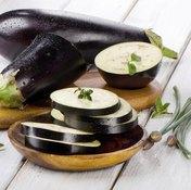 Sliced eggplants on table.