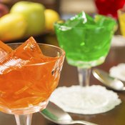 Cups filled with different coloured gelatin.