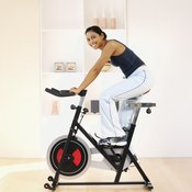 Riding an exercise bike can help you achieve your fitness goals.
