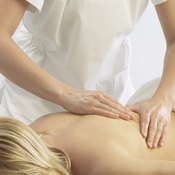 a woman receives a massage to cope with a pinched nerve.