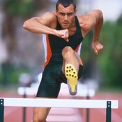 This hurdler shows off a typical uniform consisting of a lightweight tank, shorts and track spikes.
