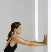 The wall pushup is performed from a standing position.