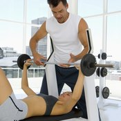 You can perform chest presses on a bench or a machine.