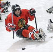 Sled hockey includes checking, slapshots and hard-core action that hockey enthusiasts expect in a game.