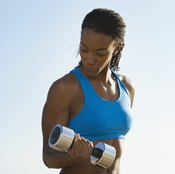 Drop one weight if you become tired while performing bicep curls.