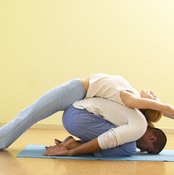 With a partner, you can achieve stretching positions that would be impossible on your own.