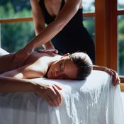 The oblique muscles can be massaged along the side of the body from the front or the back.