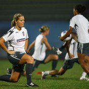 Lunges help England's women's team warm up before a match.