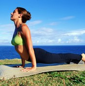 Urdvha Mukha Svanasana, or Upward-Facing Dog, demands strong lats to lift and lengthen the spine.