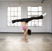 Master the handstand first and the split second.
