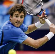 Former pro Justin Gimelstob used wristbands to help keep his grip.