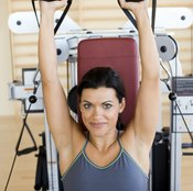 Lift your arms to perform the concentric phase of the shoulder press.