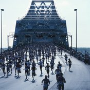 Running 26.2 miles can cause dehydration, which shows up as weight loss.