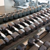 Hold heavy dumbbells to build bigger lower legs with calf and toe raises.