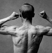 Thicken your neck for bodybuilding with heavy dumbbell or barbell shrugs.