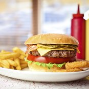 Cheeseburger and fries on diner table