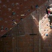 Indoor rock climbing tones your legs, buttocks and upper body.