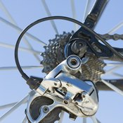 Bicycle shifters operate under tension.