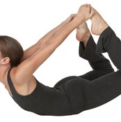 Use your abdominal muscles to lift your chest in bow pose.