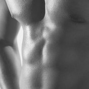Lose total body fat to slim down your chest.