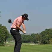 Rory McIlroy brings the club down toward the ball in a motion some compare to ringing a bell.