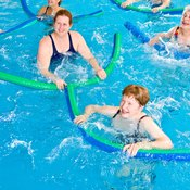 Noodles provide resistance for aquatic abdominal exercises.