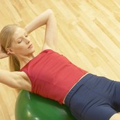 Stability ball crunches primarily target the abdominal muscles.