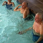 Water aerobics is a great way for elderly people to stay in shape.