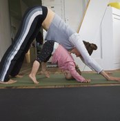 Downward-Facing Dog challenges the hamstrings, creating tightness if performed incorrectly.