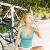 Take a break and rehydrate to get rid of shaky muscles after a workout.