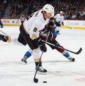 Elite hockey players such as Teemu Selanne display impressive athletic skills on the ice.