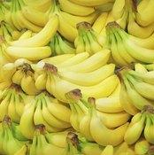 A pile of bananas at a market.