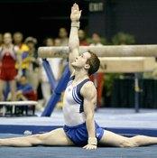 2004 USA Gymnastics national team member Morgan Hamm performs a stride split on the floor.