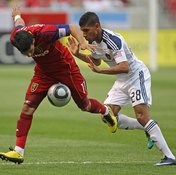 Sean Franklin of the L.A. Galaxy pushing an opponent illegally.