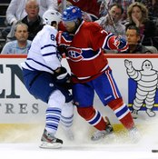 Montreal's P.K. Subban, right, leads with his shoulder to lay a clean hit onto Toronto's Mikhail Grabovski.