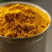 A container filled with turmeric.