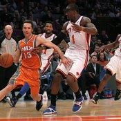 Tim Nash of the Phoenix Suns carries the ball in the frontcourt.