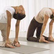 The Camel pose helps open and stretch your ribs.