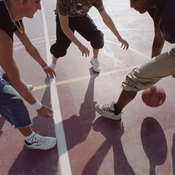 The energy to play basketball primarily comes from glycogen, which comes from carbohydrates.