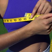 If you can't remove your shirt, a sports bra is probably thin enough to measure around.