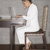 Leg raises at your desk are simple and time efficient.
