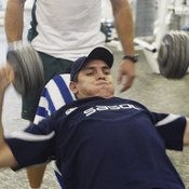 Dumbbells require more stabilization than a barbell.